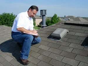 Licensed Roof Inspector in Manassas, Virginia taking notes on a residential roof.